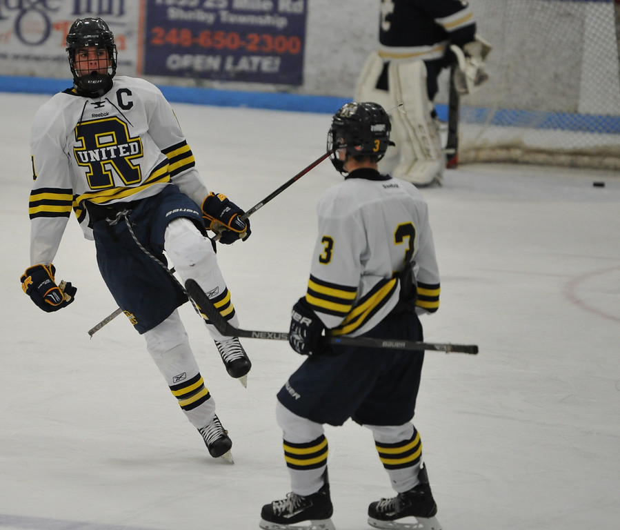 . Rochester United\'s Blake Conley (11) celebrates his 3rd period goal with teammate Tyler Drummy (3) in the game against Stoney Creek played on Wednesday November 22, 2017 at the Onyx Ice Arena in Rochester Hills.  RU lost to the Cougars 4-1.  (Oakland Press Photo by Ken Swart)