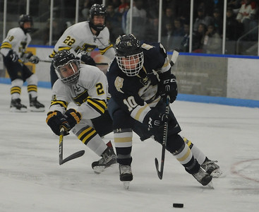 Jacob Matuski (10) of Stoney Creek moves to the net as Nico Mantios (2) of Rochester United defends during the game played on Wednesday Nov. 22, 2017 at the Onyx Ice Arena in Rochester Hills.  The Cougars defeated RU 4-1. (Oakland Press Photo by Ken Swart)