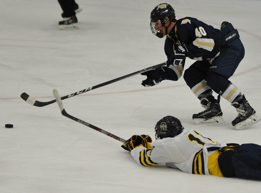 . Julian Graziani (40) of Stoney Creek beats Blake Conley (11) of Rochester United to the puck to score his first of two goals during the game played on Wednesday Nov. 22, 2017 at the Onyx Ice Arena in Rochester Hills.  The Cougars defeated RU 4-1. (Oakland Press Photo by Ken Swart)
