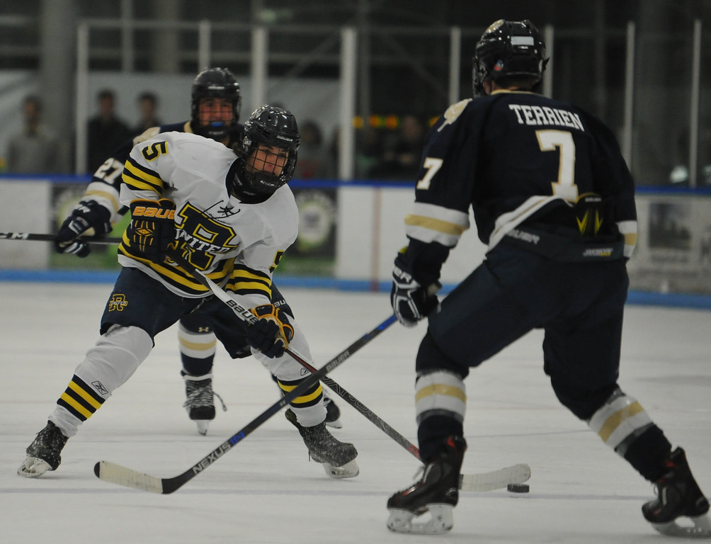 . Rochester United\'s Drew Stempian (5) looks to shoot past Stoney Creek defenseman Ben Terrien (7) during the game played on Wednesday November 22, 2017 at the Onyx Ice Arena in Rochester Hills. RU lost to the Cougars 4-1. (Oakland Press Photo by Ken Swart)