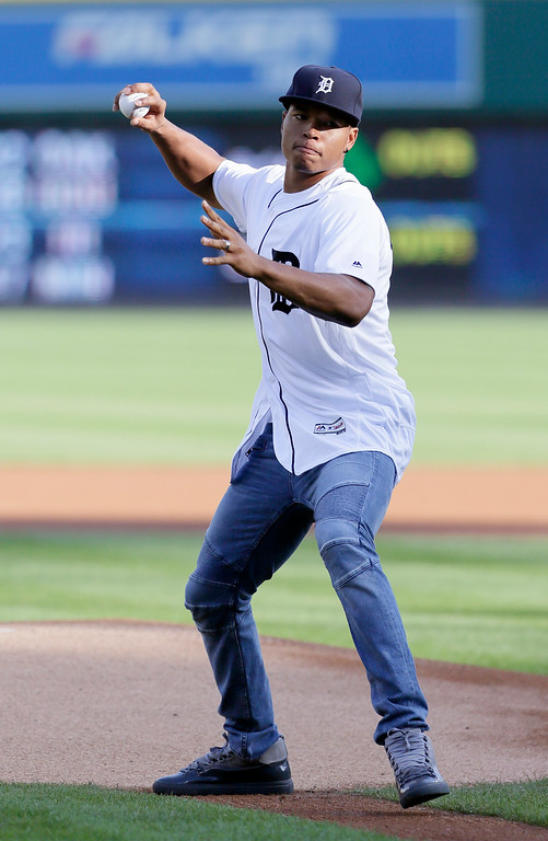 . Detroit Lions wide receiver Marvin Jones, who signed with the Lions this off-season, tosses a ceremonial first pitch before the Detroit Tigers baseball game against the Chicago White Sox at Comerica Park Friday, June 3, 2016, in Detroit. (AP Photo/Duane Burleson)