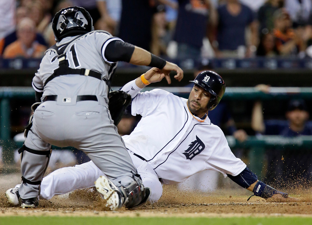 . Detroit Tigers\' Mike Aviles, right, slides into the tag from Chicago White Sox catcher Alex Avila during the sixth inning of a baseball game Friday, June 3, 2016, in Detroit. Aviles tried to score from first base but was thrown out by Chicago White Sox center fielder J.B. Shuck. (AP Photo/Duane Burleson)