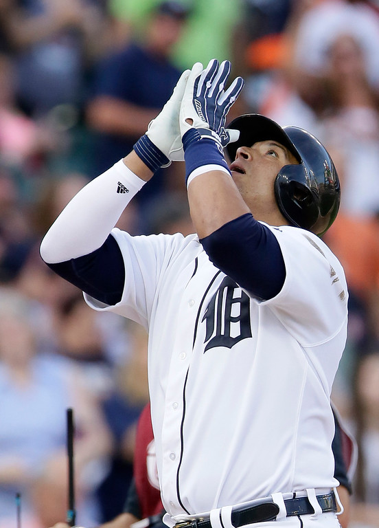 . Detroit Tigers\' Victor Martinez celebrates his solo home run against the Chicago White Sox during the third inning of a baseball game Friday, June 3, 2016, in Detroit. (AP Photo/Duane Burleson)