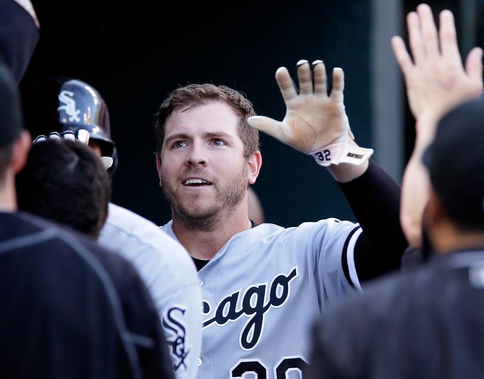 . Chicago White Sox\'s J.B. Shuck celebrates in the dugout after scoring against the Detroit Tigers on a single by Avisail Garcia during the second inning of a baseball game Friday, June 3, 2016, in Detroit. (AP Photo/Duane Burleson)