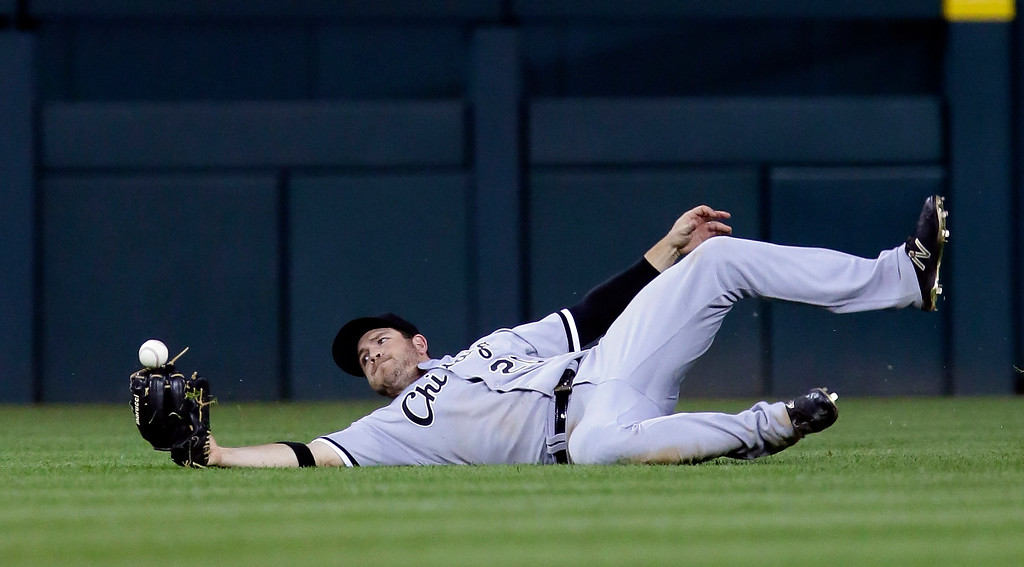 . Chicago White Sox center fielder J.B. Shuck can\'t hang on to the fly ball hit by Detroit Tigers\' James McCann for a single during the sixth inning of a baseball game Friday, June 3, 2016, in Detroit. Detroit\'s J.D. Martinez scored on the single but Shuck managed to throw out Mike Aviles trying to score from first base. (AP Photo/Duane Burleson)