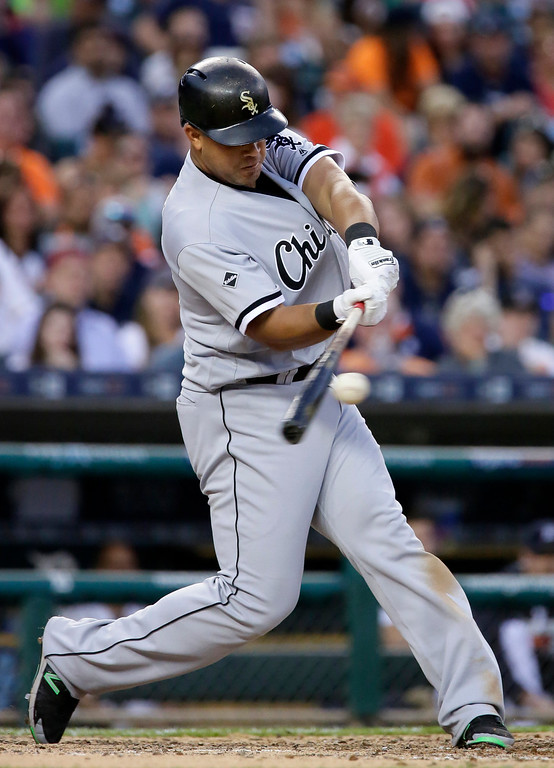 . Chicago White Sox\'s Jose Abreu hits a double to drive in Todd Frazier against the Detroit Tigers during the sixth inning of a baseball game Friday, June 3, 2016, in Detroit. (AP Photo/Duane Burleson)