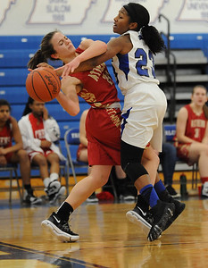 Rochester's Tori Hawkins (23) puts some heavy pressure on Troy Athens' Emma Wodwaski (L) during the OAA White match up played on Thursday Feb. 22, 2018 at Rochester High School.  The Falcons lost to the Red Hawks 35-28.  (Oakland Press photo by Ken Swart)