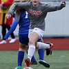 Troy Athens squares off against Rochester in varsity soccer action at Athens Thursday, April 13, 2017. (MIPrepZone photo / LARRY McKEE)