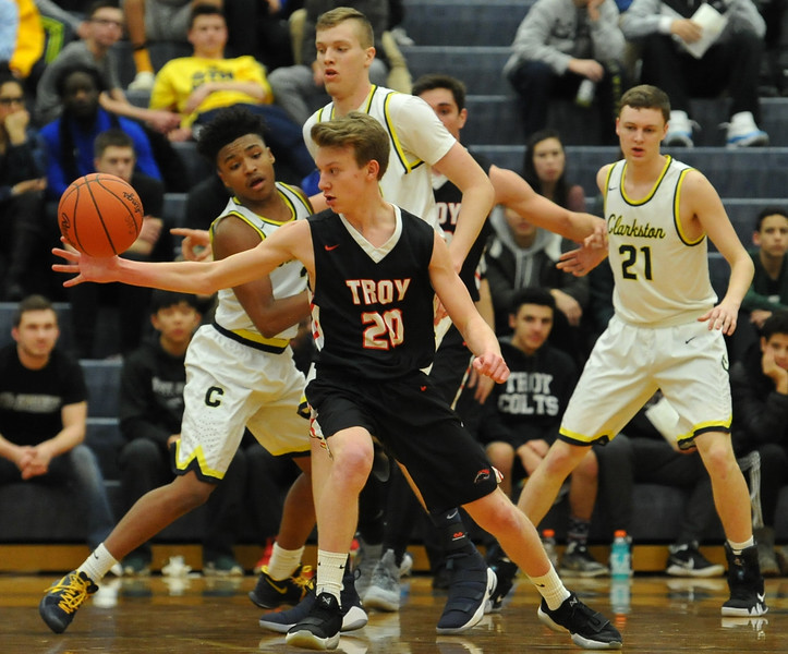 The Clarkston Wolves defeated the Troy Colts 58-49 in the OAA Red battle played on Friday February 15, 2018 at Clarkston High School.  (Oakland Press photo by Ken Swart)