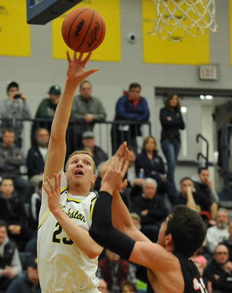 Taylor Currie of Clarkston puts up a shot over Troy's Danny Sully during the OAA Red matchup played on Friday February 15, 2018 at Clarkston High School.  The Wolves defeated the Colts 58-49. (Oakland Press photo by Ken Swart)