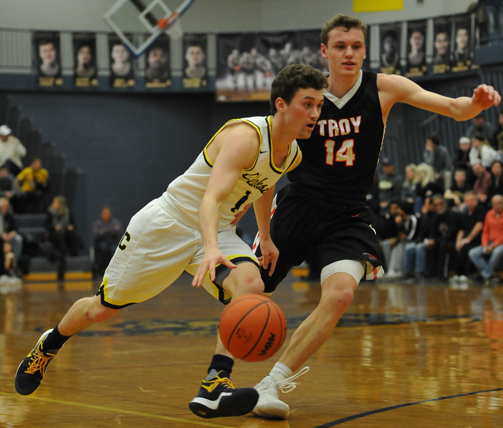 Clarkston's Foster Loyer (1) moves past Troy's Jason Dietz (14) During the OAA Red battle played on Friday February 15, 2018 at Clarkston High School.  Loyer had 28 points to help lead the Wolves to a 58-49 win.  (Oakland Press photo by Ken Swart)