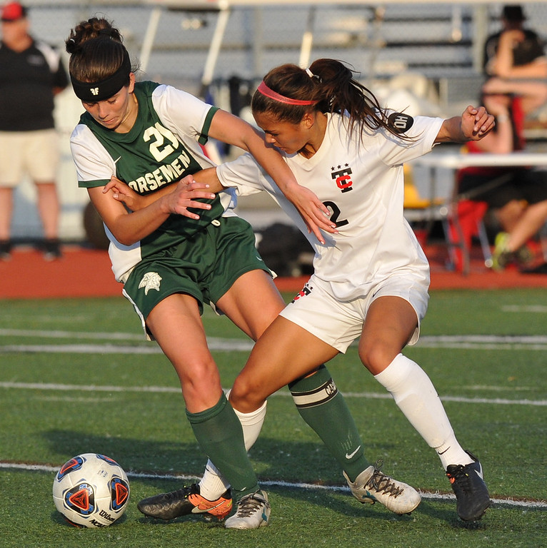 . Brianna Nogoy (12) of Troy battles with Lauren Sickmiller (21) of Grosse Pointe North during the MHSAA D1 Regional final played on Thursday June 7, 2018 at Troy Athens HS.  The Colts won the match 5-0 and will play Novi in next Tuesday\'s Semi-final match at Stoney Creek HS.  (Oakland Press photo by Ken Swart)