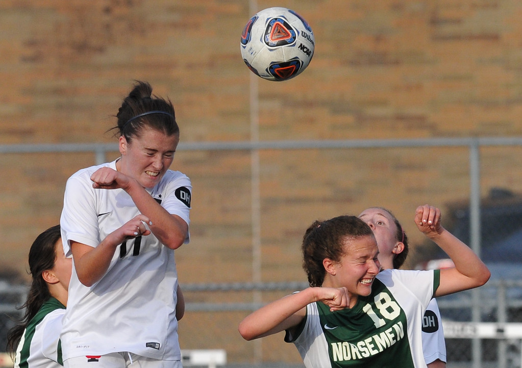 . Troy\'s Stephanie O\'Keefe (11) connects for a header goal off a corner kick over GPN\'s Katelyn Louwers (18) during the MHSAA D1 Regional final played on Thursday June 7, 2018 at Troy Athens HS.  The Colts won the match 5-0 and will play Novi in next Tuesday\'s Semi-final match at Stoney Creek HS.  (Oakland Press photo by Ken Swart)