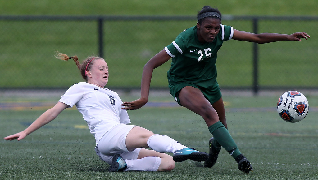 . Lauren Calhoun (25), Novi, gets past Hailey Stewart, Troy, during Division 1 semifinal soccer action at Rochester Stoney Creek High School Tuesday, June 12, 2018. Novi took an early lead and never looked back downing the Colts 4-1. (For The Oakland Press / LARRY McKEE)