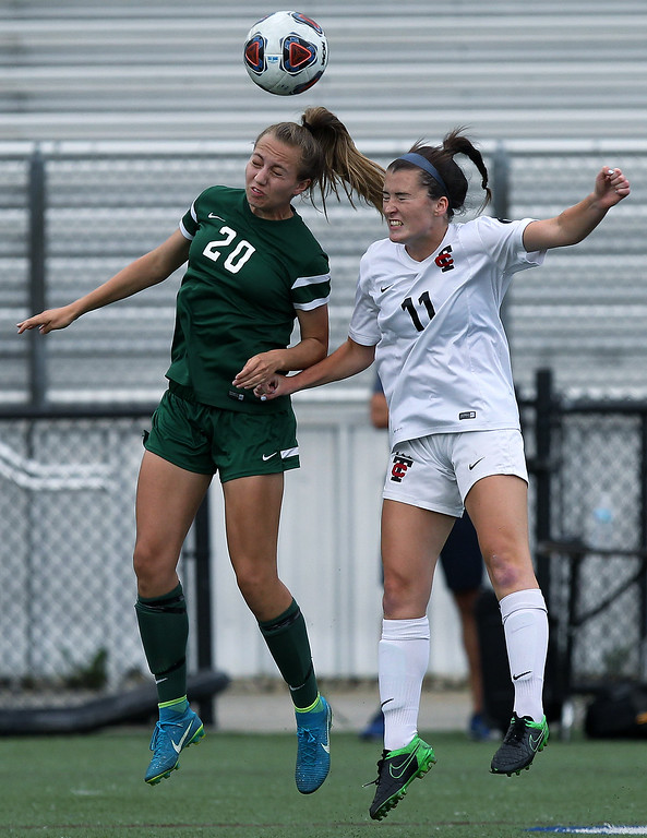 . Julia Stadtherr (20), Novi, collides with Stephanie O\'Keefe (11),Troy, going up for a header during Division 1 semifinal soccer action at Rochester Stoney Creek High School Tuesday, June 12, 2018. Novi defeated the Colts 4-1. (For The Oakland Press / LARRY McKEE)