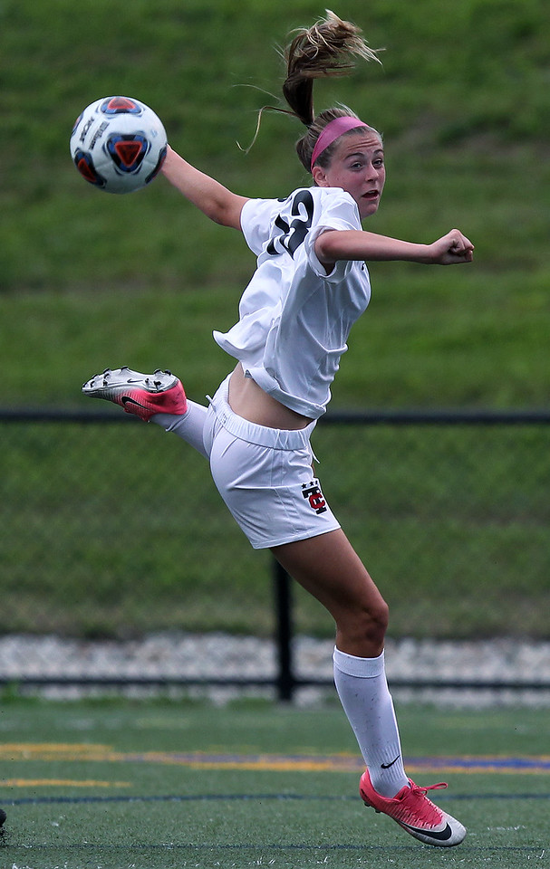 Sophia Bongiovani Troy, makes a header pass during Division 1 semifinal soccer action against Novi at Rochester Stoney Creek High School Tuesday, June 12, 2018. Novi downed the Colts 4-1. (For The Oakland Press / LARRY McKEE)