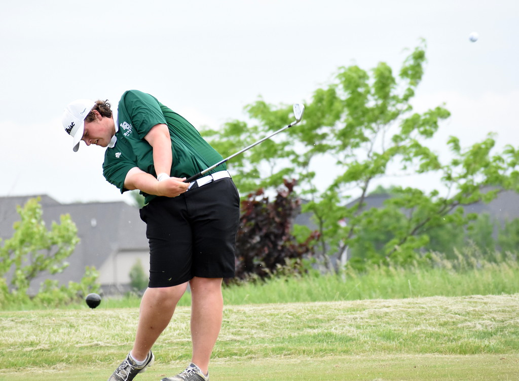 . Lake Orion junior Drew Coble hits a drive at the par-3 16th hole Wednesday at the Division 1 regional tournament. Coble fired a 73 to help his team qualify for the state tournament. (Digital First Media photo by Jason Schmitt)
