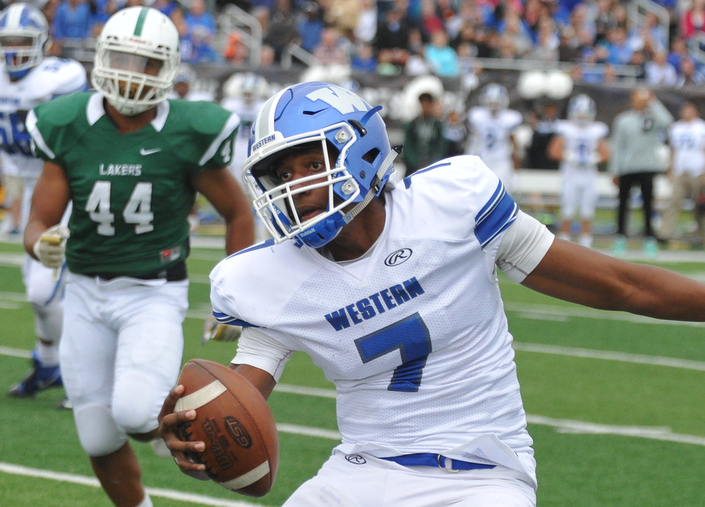 . Walled Lake Western quarterback Sam Johnson (7) moves upfield as West Bloomfield�s Cornelll Wheeler (44) pursues during the Xenith Prep Kickoff Classic game played on Thursday August 24, 2017 at Wayne State University.  The Warriors defeated the Lakers 19-14.  (Oakland Press Photo by Ken Swart)