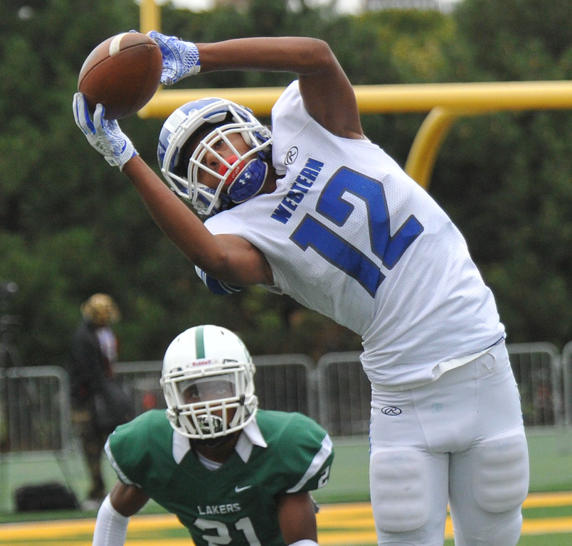 . Walled Lake Western�s Abdur-Rahmann Yaseen (12) makes a leaping catch as West Bloomfield�s Chase Swoope (21) defends during the Xenith Prep Kickoff Classic game played on Thursday August 24, 2017 at Wayne State University.  The Warriors defeated the Lakers 19-14.    (Oakland Press photo by Ken Swart)