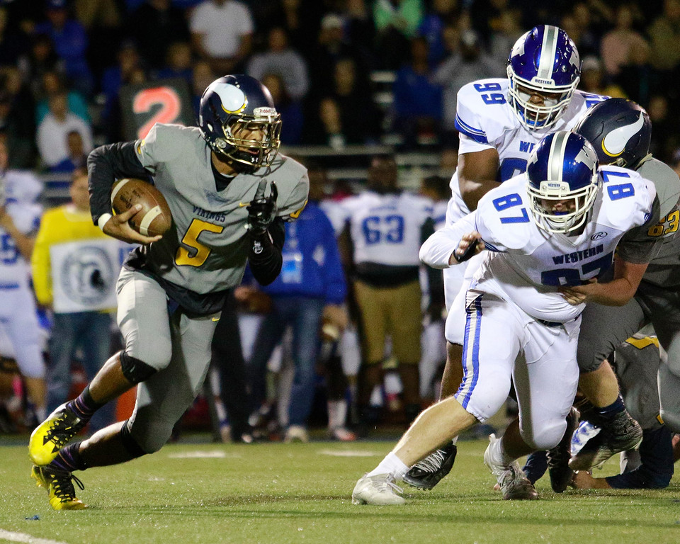 . Walled Lake Western exploded for 28 points in a nine-minute span Friday night to roll to a 42-0 victory over rival Walled Lake Central. (Oakland Press photo by Timothy Arrick)