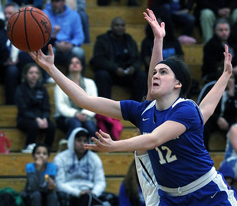 Sarah Rachiele, Walled Lake Western, slips through defenders in the paint for two points during varsity basketball action at Waterford Mott High School Tuesday, Jan 8, 2019. The Warriors downed Mott 64-40. (For The Oakland Press / LARRY McKEE)