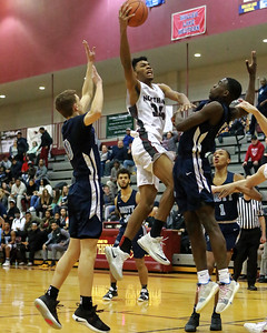 Through three quarters, Mott kept things close with Walled Lake Northern but in the fourth, the Knights turned up then heat and ran away with a 77-46 victory Friday January 11, 2019 in Walled Lake. (Oakland Press photo by Timothy Arrick)