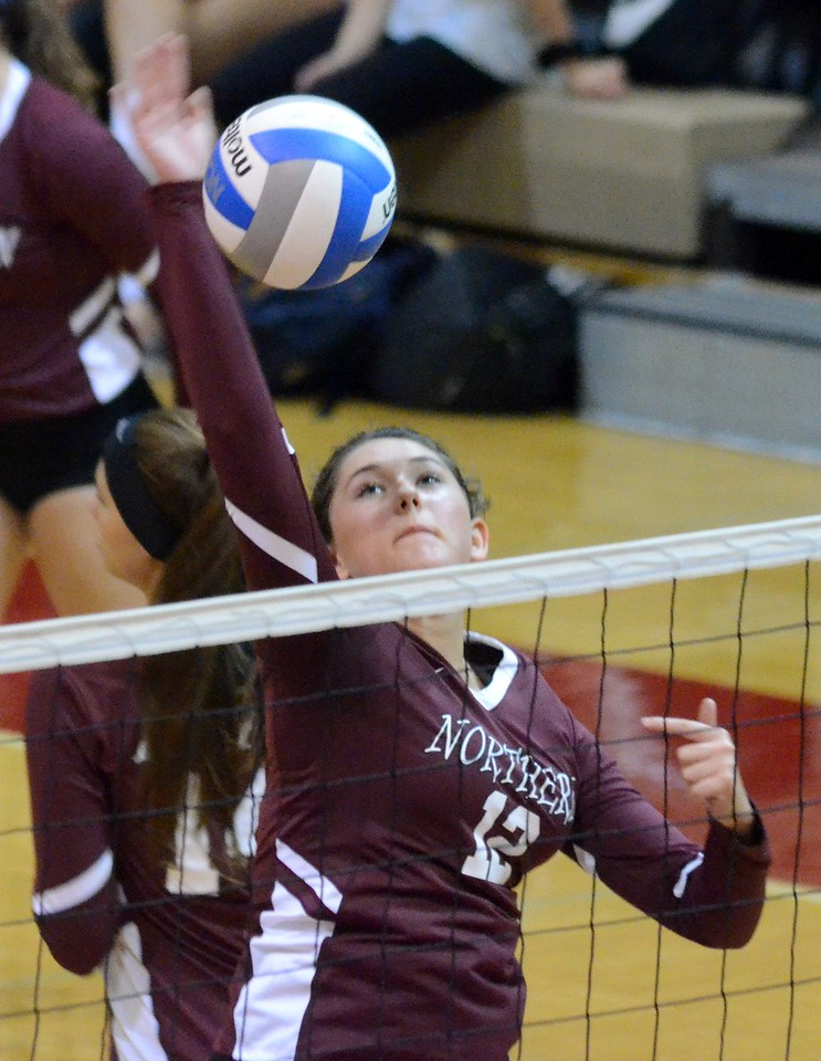 Milford opened Lakes Valley Conference volleyball play on Tuesday when it hosted Walled Lake Northern. The Mavericks came away with the win in five sets, 25-18, 20-25, 26-24, 20-25, 15-11. (Oakland Press photo by Drew Ellis)