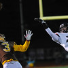 Rochester Adams' Mark Patritto (3) makes a one handed catch behind Waterford Mott's Pat Bicknell (22) during the MHSAA D1 Pre-district game played on Friday October 28, 2016 at Adams HS.  The Highlanders lost to the Corsairs 28-21.  (MIPrepZone photo by Ken Swart)