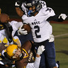 Waterford Mott's Keith Fields (2) breaks through the tackle attempt of Rochester Adams' John Filbin for a touchdown during the MHSAA D1 Pre-district game played on Friday October 28, 2016 at Adams HS.  The Corsairs won the game 28-21.  (MIPrepZone photo by Ken Swart)