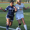 Leah Bolitho (24) of Walled Lake Central and Kayli Loza (1) battle for the ball during the match played on Tuesday May 9, 2017 at WLC High School.  The Vikings lost to the Corsairs 3-1. (MIPrepZone photo by Ken Swart)