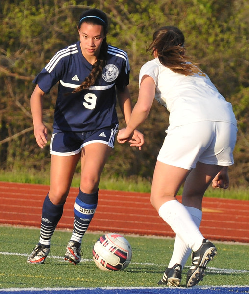 Jasmin Messer (9) of Waterford Mott looks to move past Jenna Jackson of Walled Lake Central during the match played on Tuesday May 9, 2017 at WLC High School.  Messer had 2 goals to help lead the Corsairs to a 3-1 win over the Vikings. (MIPrepZone photo by Ken Swart)