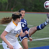 Jasmin Messer (9) of Waterford Mott gets a leg up on Walled Lake Central's Macy Robison during the match played on Tuesday May 9, 2017 at WLC High School.  Messer had 2 goals to help lead the Corsairs to a 3-1 win over the Vikings. (MIPrepZone photo by Ken Swart)