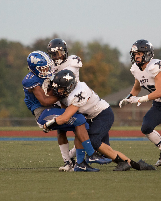 . Waterford Mott came into Walled Lake Western and scored on 5 of their first 6 possessions to defeat the Warriors 47-37 in Lakes Valley Conference action Friday night. (Oakland Press photo by Timothy Arrick)
