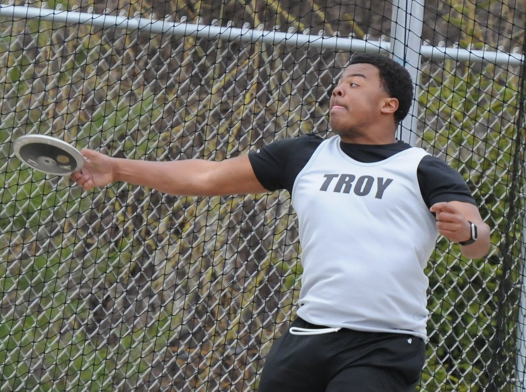 """. Tre Harewood of Troy throws the discus 120\' 4\"""" to place 5th during the 45th annual Ashley/Brennan Relays that were held on Saturday April 28, 2018 at Waterford Mott HS.  Lake Orion won both the boys and girls title. (Oakland Press photo by Ken Swart)"""