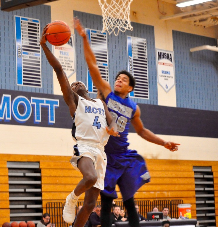 . Waterford Mott hosted Walled Lake Western for a Lakes Valley Conference boys basketball game on Tuesday, Feb. 13, 2018. (Photo gallery by Dan Fenner/The Oakland Press)