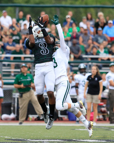 Laker WR Taj Mustapha (3) hauls in a first quarter pass from QB Bryce Veasley (8) as West Bloomfield defeated Lake Orion 37-7 Friday night in West Bloomfield. (MIPrepZone photo by Timothy Arrick)