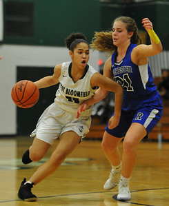 Maya Bobo (L) of West Bloomfield drives past Rochester's Jenna Norgrove (21) during the OAA White match up played on Tuesday February 20, 2018 at West Bloomfield HS.  The Lakers defeated the Falcons 58-46.  (Oakland Press photo by Ken Swart)