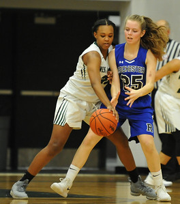 West Bloomfield's Mikayla Duncan (L) goes for the steal from Rochester's Sam Thiessen (25) during the OAA White match up played on Tuesday February 20, 2018 at West Bloomfield HS.  The Lakers defeated the Falcons 58-46.  (Oakland Press photo by Ken Swart)