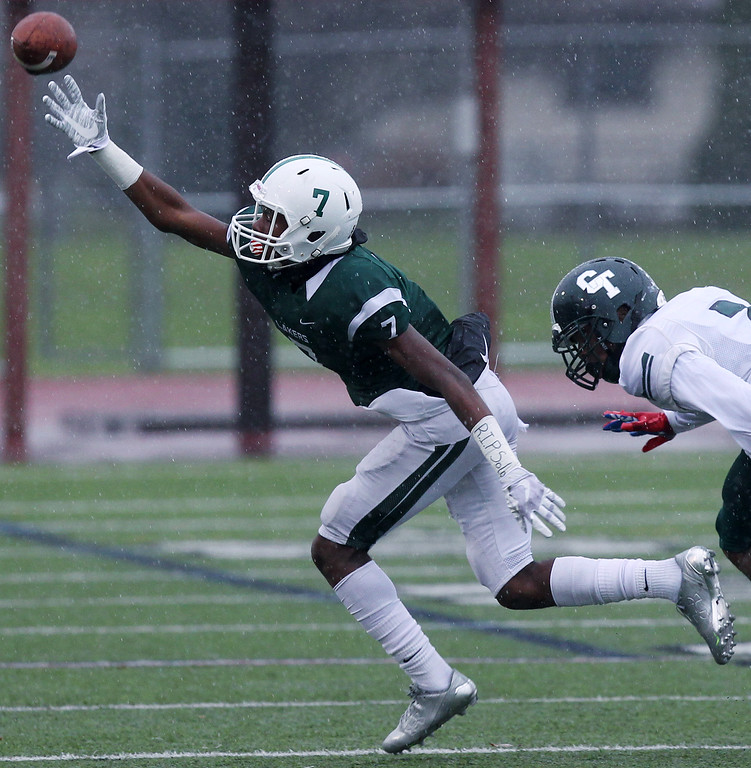 . Tre Mosley (7), West Bloomfield, attempts to make a reception during Division 1 semifinal football action against Detroit Cass Tech at Troy Athens High School Saturday, Nov. 18, 2017. The Lakers defeated Cass Tech in a defensive battle 9-7. (For The Oakland Press / LARRY McKEE)