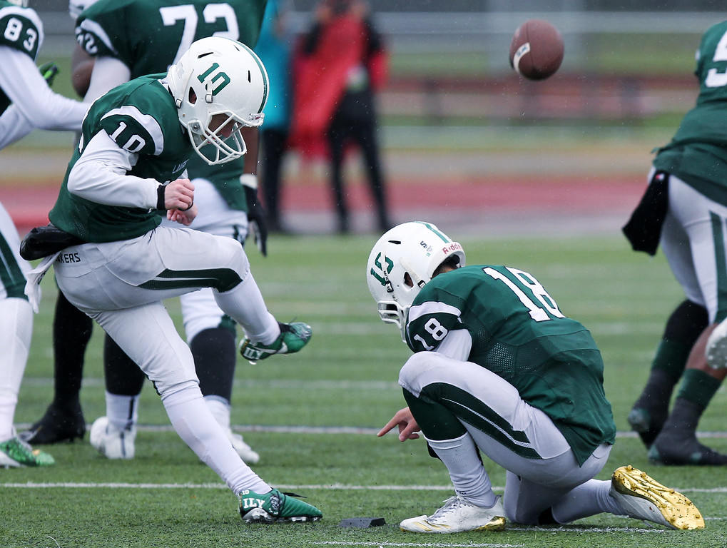. Place kicker Nick O\'Shea (10), West Bloomfield, accounted for all the Lakers points during the Lakers Division 1 semifinal football contest against Detroit Cass Tech at Troy Athens High School Saturday, Nov. 18, 2017. O\'Shea connected for three field goals, with help from holder Nick Seidel (18), to give the Lakers a narrow 9-7 victory. (For The Oakland Press / LARRY McKEE)
