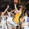 Rochester Adams' Maggie Rogers (center) is a second-team All-Oakland County selection for 2016-17. (MIPrepZone file photo)