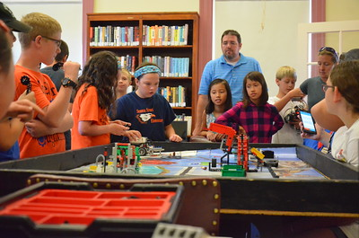 John Brewer - Oneida Daily Dispatch Kids take part in Lego Robotics at the Oneida Public Library on Friday, Aug. 19, 2016.