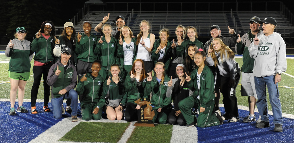 . The Lake Orion Dragon girls track team show off the trophy they earned by winning the MHSAA D1 regional held on Friday May 18, 2018 at Rochester High School.  (Oakland Press photo by Ken Swart)