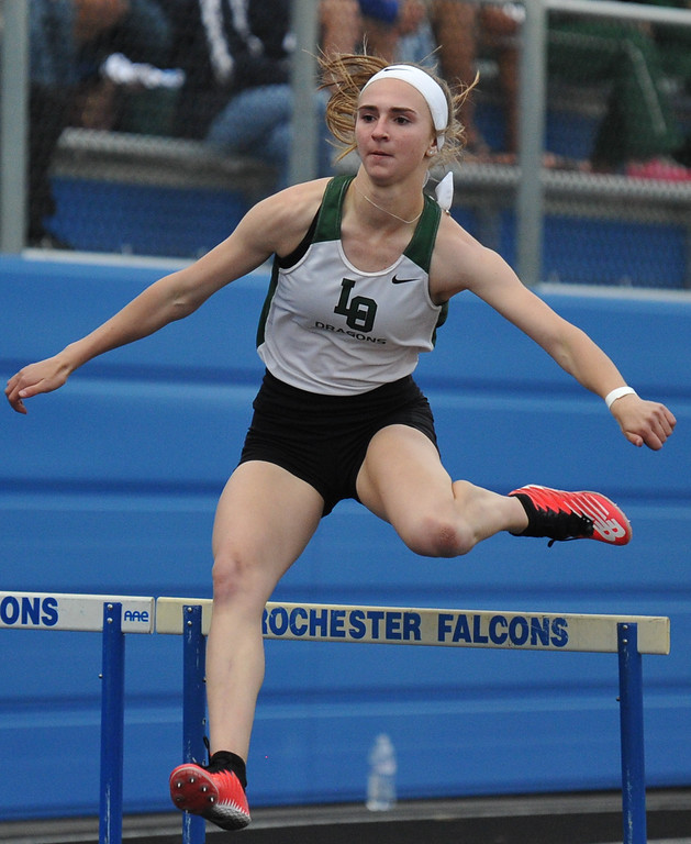 . Lake Orion\'s Melissa Symons clears a hurdle on her way to winning the 300M event during the MHSAA D1 Regional meet held on Friday May 18, 2018 at Rochester High School.  Symons won 4 events on the day to help lead the Dragons to the title. (Oakland Press photo by Ken Swart)