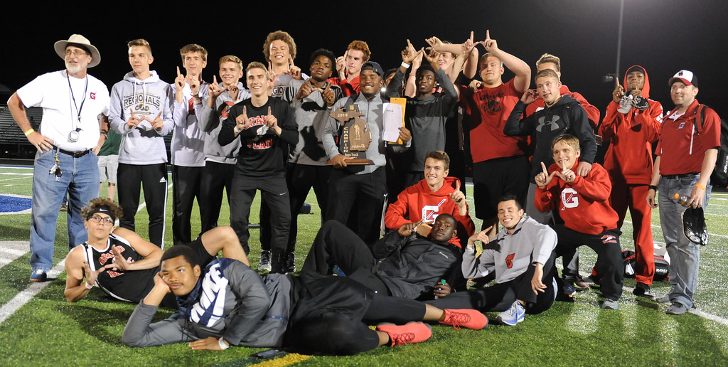 . The Grand Blanc boys track team show off the trophy they earned by winning the MHSAA D1 regional held on Friday May 18, 2018 at Rochester High School.  (Oakland Press photo by Ken Swart)
