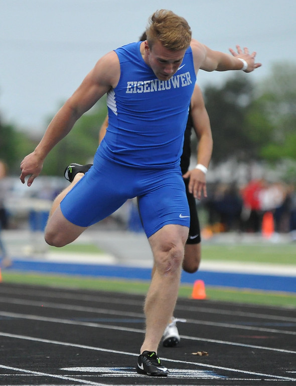 . Utica Eisenhower\'s Caleb Oyster leans to win the 200M event during the MHSAA D1 Regional meet held on Friday May 18, 2018 at Rochester High School.  (Oakland Press photo by Ken Swart)