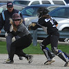 Birmingham Seaholm's Kelly DeClark (L) is caught in a run down by Warren Woods Tower catcher Sam Marin during the 4 team round robin held at Birmingham Groves HS on Saturday April 22, 2017.  Seaholm, WWT, and Groves ended the day 2-1 with Bloomfield Hills going 0-3.  (MIPrepZone photo by Ken Swart)