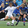 Birmingham Marian's Neve Badalow (5) clears the ball upfield in front of Warren Regina's Betsy Lueck (14) during the CHSL Division 1 final played on Saturday May 20, 2017 at Madonna University.  The Mustangs won the title with a 1-0 win over the Saddlelites in shoot out.  (MIPrepZone photo by Ken Swart)