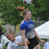 Regina's Audrey Fleming (22) heads the ball away from Marian's Claudia Schilling (10) during the CHSL D1 finals held on Saturday May 20, 2017 at Madonna University.  The Saddleites lost to the Mustangs 1-0 in a shoot out.  (MIPrepZone photo by Ken Swart)