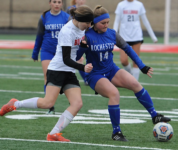 Rochester's Kaitlin DuCharme (14) controls the ball as Romeo's Chloe Lucci defends during the OAA/MAC match played on Monday March 26, 2018 at Romeo High School.  DuCharme had a goal to help lead the Falcons to a 2-0 win.  (Digital First Media photo by Ken Swart)